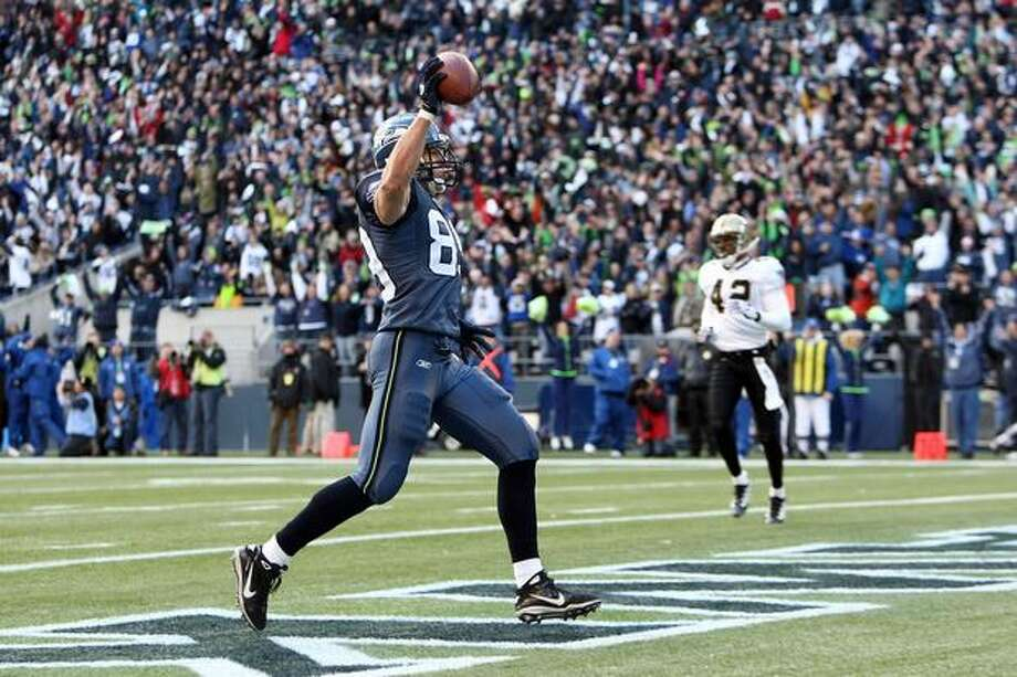 Tight end John Carlson #89 of the Seattle Seahawks celebrates his 11-yard touchdown reception in the first quarter against the New Orleans Saints during the 2011 NFC wild-card playoff game at Qwest Field on January 8, 2011 in Seattle, Washington. Photo: Getty Images / Getty Images