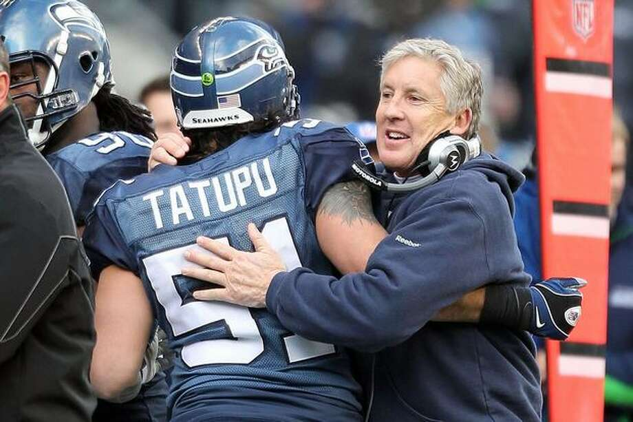 Head coach Pete Carroll of the Seattle Seahawks reacts in the second quarter with Lofa Tatupu #51 against the New Orleans Saints during the 2011 NFC wild-card playoff game at Qwest Field on January 8, 2011 in Seattle, Washington. Photo: Getty Images / Getty Images