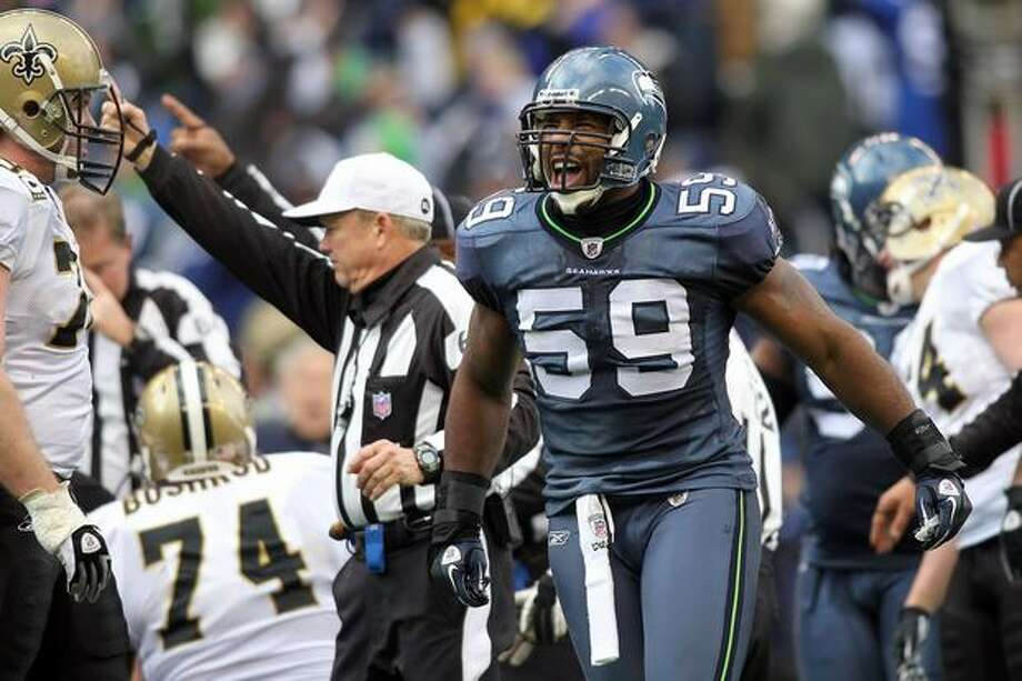 Linebacker Aaron Curry #59 of the Seattle Seahawks reacts after the Seahawks force a turnover in the second quarter against the New Orleans Saints during the 2011 NFC wild-card playoff game at Qwest Field on January 8, 2011 in Seattle, Washington. Photo: Getty Images / Getty Images