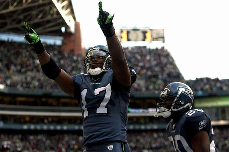 Wide receiver Mike Williams #17 of the Seattle Seahawks reacts after catching a 38-yard third quarter touchdown pass against the New Orleans Saints during the 2011 NFC wild-card playoff game at Qwest Field on January 8, 2011 in Seattle, Washington. Photo: Getty Images / Getty Images