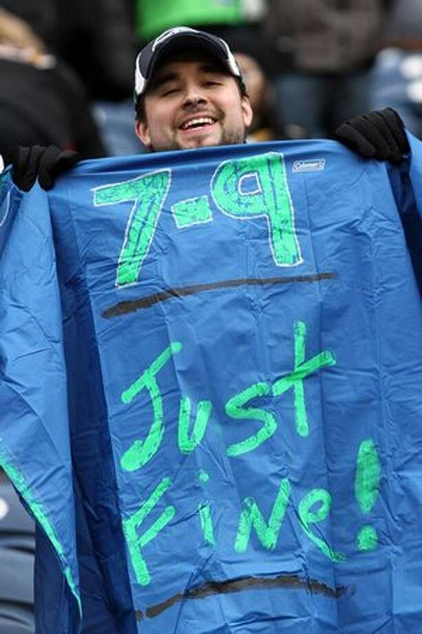 A Seattle Seahawks holds a sign as the Seahawks take on the New Orleans Saints during the 2011 NFC wild-card playoff game at Qwest Field on January 8, 2011 in Seattle, Washington. Photo: Getty Images / Getty Images