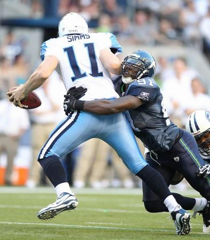 Chris Clemons #91 of the Seahawks sacks quarterback Chris Simms #11 during the preseason game against the Tennessee Titans at Qwest Field on August 14, 2010 in Seattle, Washington. Photo: Getty Images / Getty Images