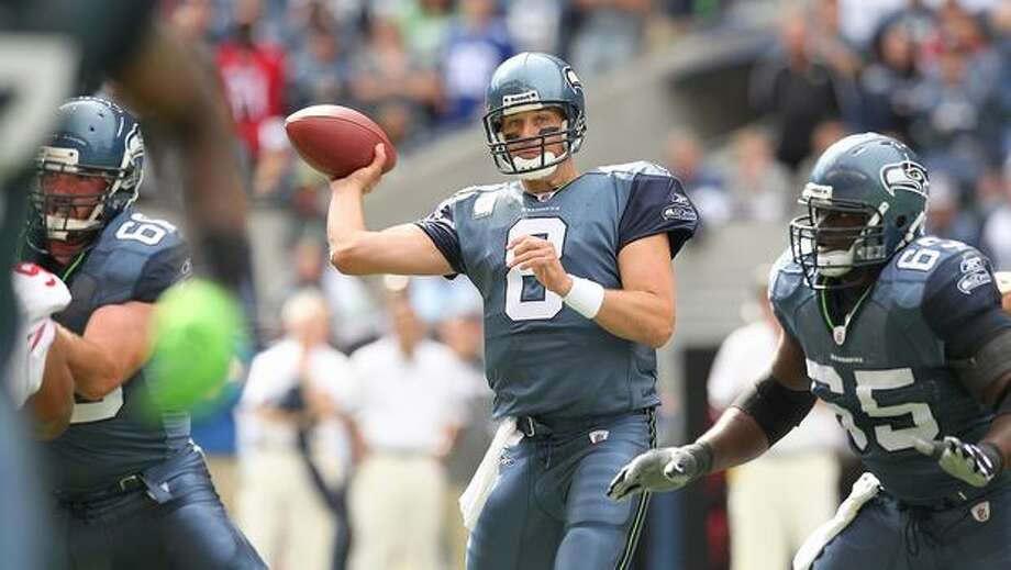 Quarterback Matt Hasselbeck #8 of the Seahawks passes. Photo: Getty Images / Getty Images