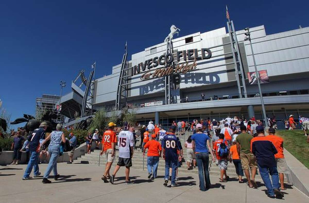 Fans head for the gates as the Seattle Seahawks face the Denver Broncos at INVESCO Field at Mile High.