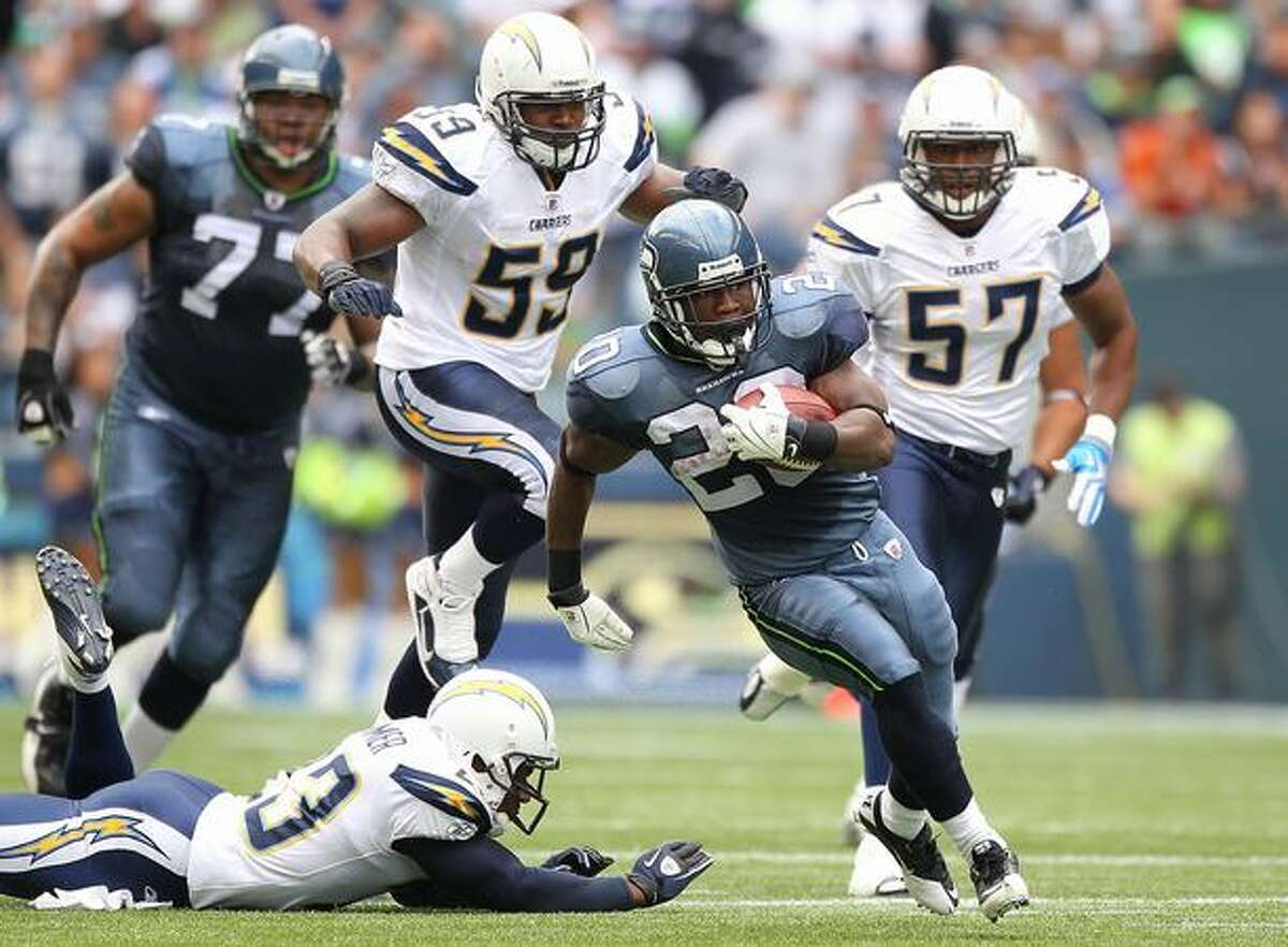 Running back Justin Forsett #20 of the Seattle Seahawks rushes against Brandon Siler #59 of the San Diego Chargers at Qwest Field in Seattle on Sunday, Sept. 26, 2010.