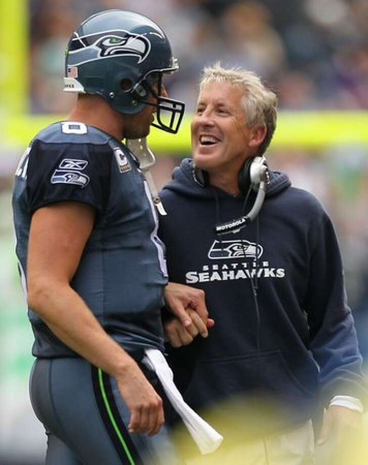Head coach Pete Carroll of the Seattle Seahawks smiles as he talks to quarterback Matt Hasselbeck #8 after a touchdown against the San Diego Chargers. The Seahawks defeated the Chargers 27-20. Photo: Getty Images / Getty Images