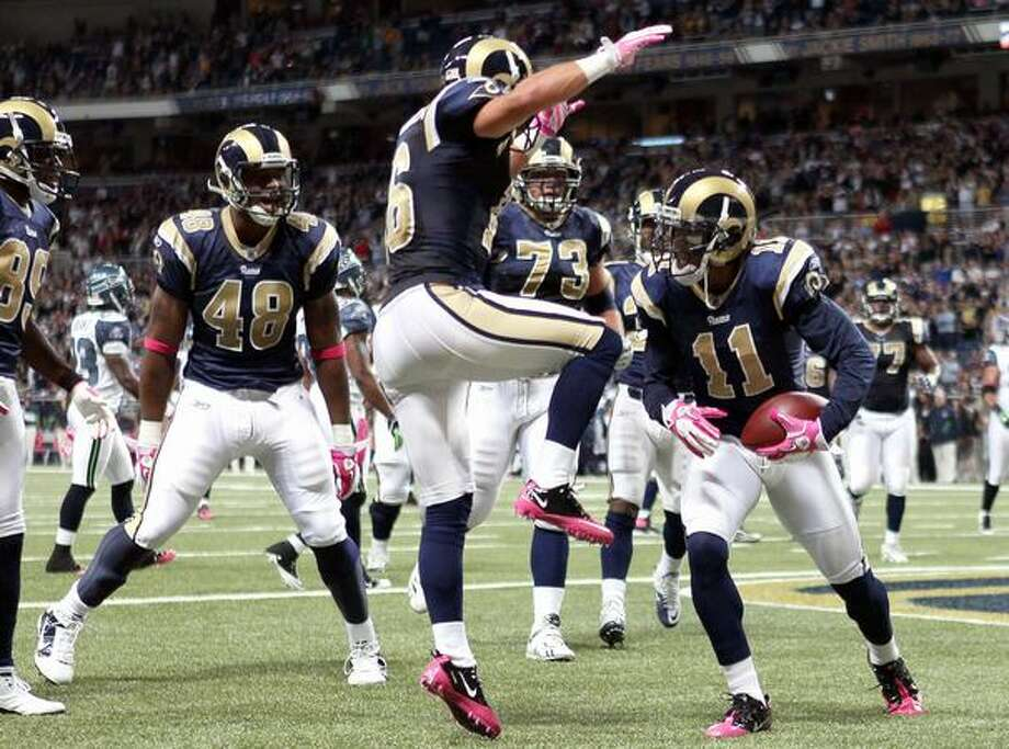 Brandon Gibson #11 of the St. Louis Rams is congratulated by teammates Danny Amendola #16, Fendi Onobun #48 and Adam Goldberg #73 after Gibson scored a touchdown in the first half against the Seattle Seahawks at the Edward Jones Dome in St. Louis on Sunday, Oct. 3, 2010. Photo: Getty Images / Getty Images
