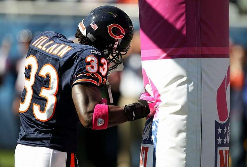 Charles Tillman #33 of the Chicago Bears uses the goal post as a punching bag during warm-ups before a game against the Seattle Seahawks in Chicago on Sunday, Oct. 17, 2010.