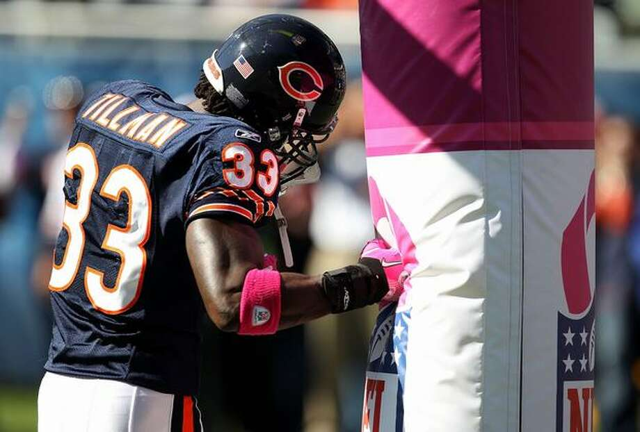 Charles Tillman #33 of the Chicago Bears uses the goal post as a punching bag during warm-ups before a game against the Seattle Seahawks in Chicago on Sunday, Oct. 17, 2010. Photo: Getty Images / Getty Images