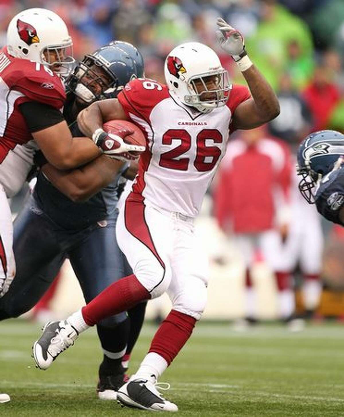 Running back Beanie Wells #26 of the Arizona Cardinals rushes against the Seattle Seahawks at Qwest Field in Seattle on Sunday, Oct. 24, 2010.
