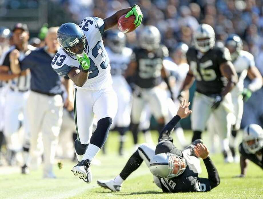 Leon Washington #33 of the Seattle Seahawks tries to stay in bounds on a punt return against the Oakland Raiders at Oakland-Alameda County Coliseum in Oakland, Calif., on Sunday, Oct. 31, 2010. Photo: Getty Images / Getty Images