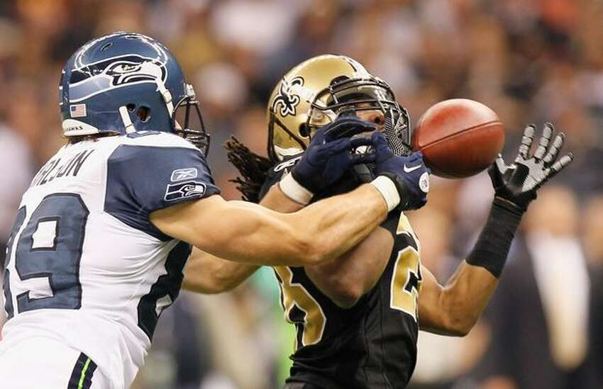 Usama Young (28) of the New Orleans Saints nearly picks off a pass intended for John Carlson (89) of the Seattle Seahawks at Louisiana Superdome in New Orleans.