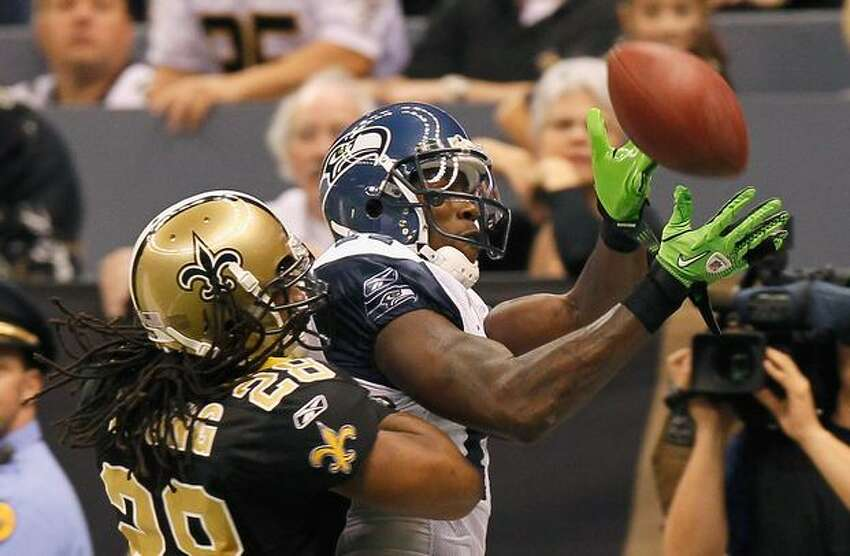 Mike Williams (17) of the Seattle Seahawks fails to pull in this touchdown reception against Usama Young (28) of the New Orleans Saints at Louisiana Superdome in New Orleans.