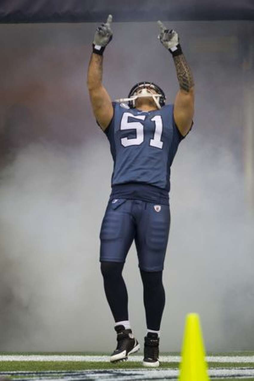 Seahawk's linebacker Lofa Tatupu points skyward as he is introduced before the game. He interecepted a pass and retured it 26-yards for a touchdown in the third quarter as the Seattle Seahawks beat the Carolina Panthers 31-14.