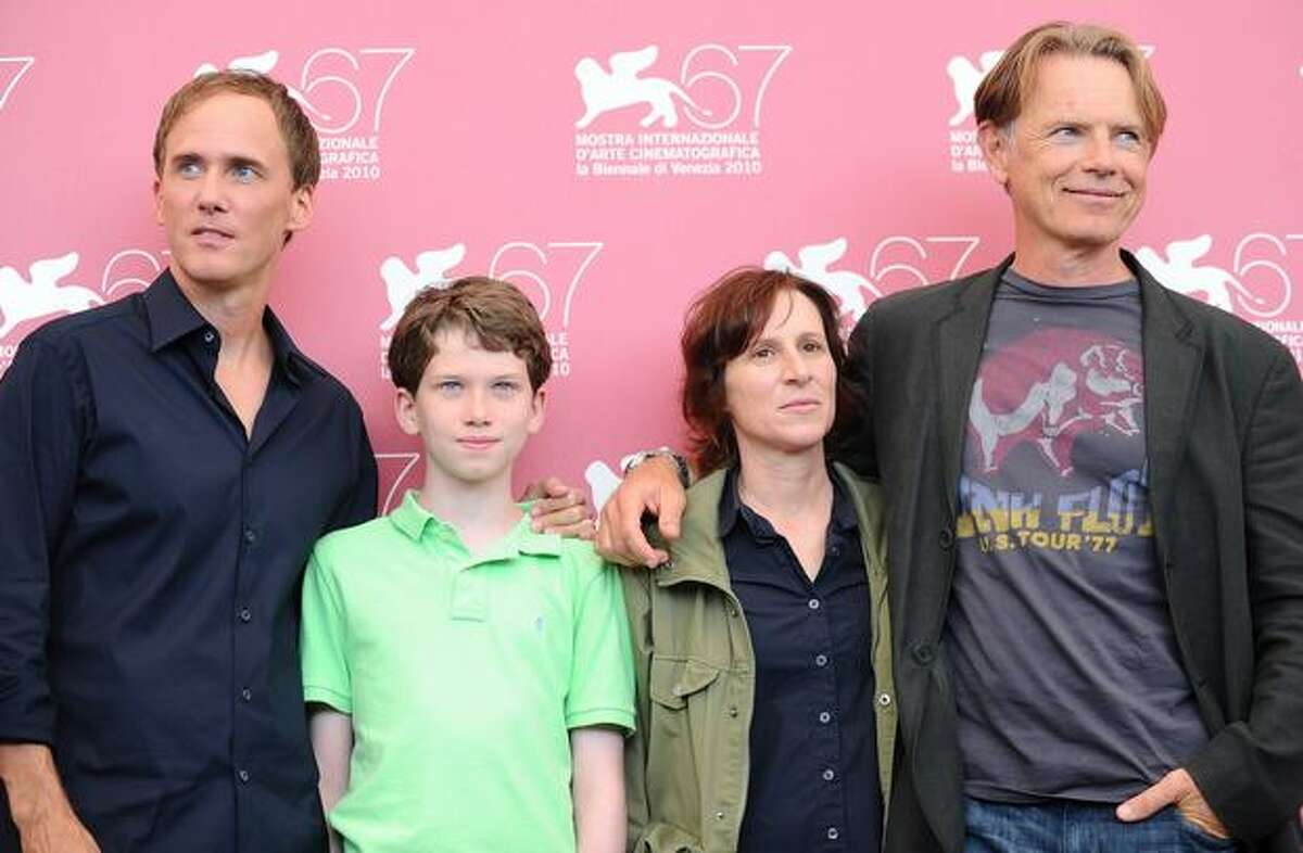 (From L) US actor Neal Huff, actor Tommy Nelson, film director Kelly Reichardt and and actor Bruce Greenwood pose during the photocall of