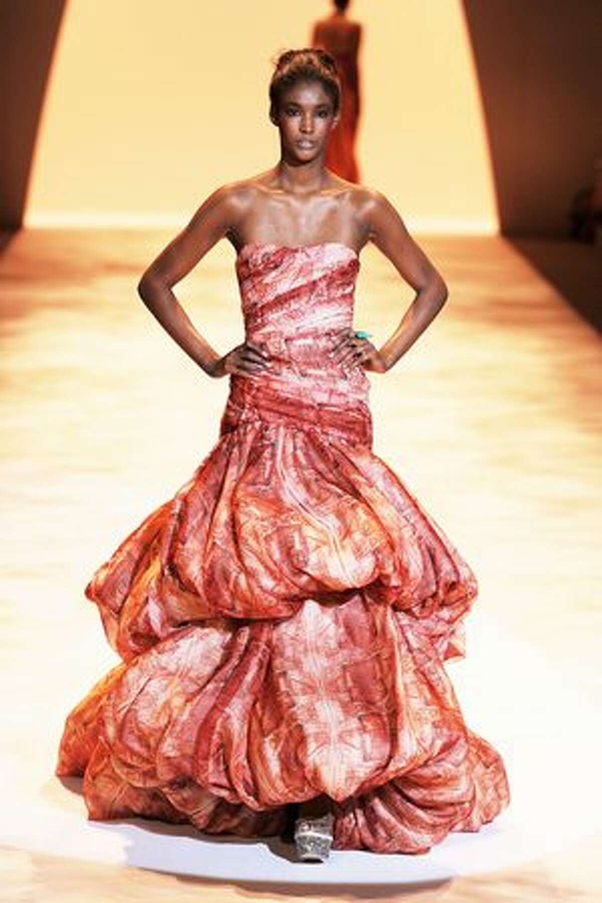 A model walks the runway at the Christian Siriano Spring 2011 fashion show during Mercedes-Benz Fashion Week at The Stage at Lincoln Center in New York City.