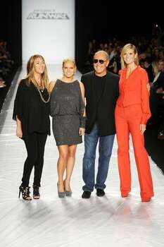 (L-R) Nina Garcia, Jessica Simpson, Michael Kors and Heidi Klum pose on the runway at the Project Runway Spring 2011 fashion show during Mercedes-Benz Fashion Week at The Theater at Lincoln Center in New York City. Photo: Getty Images / Getty Images