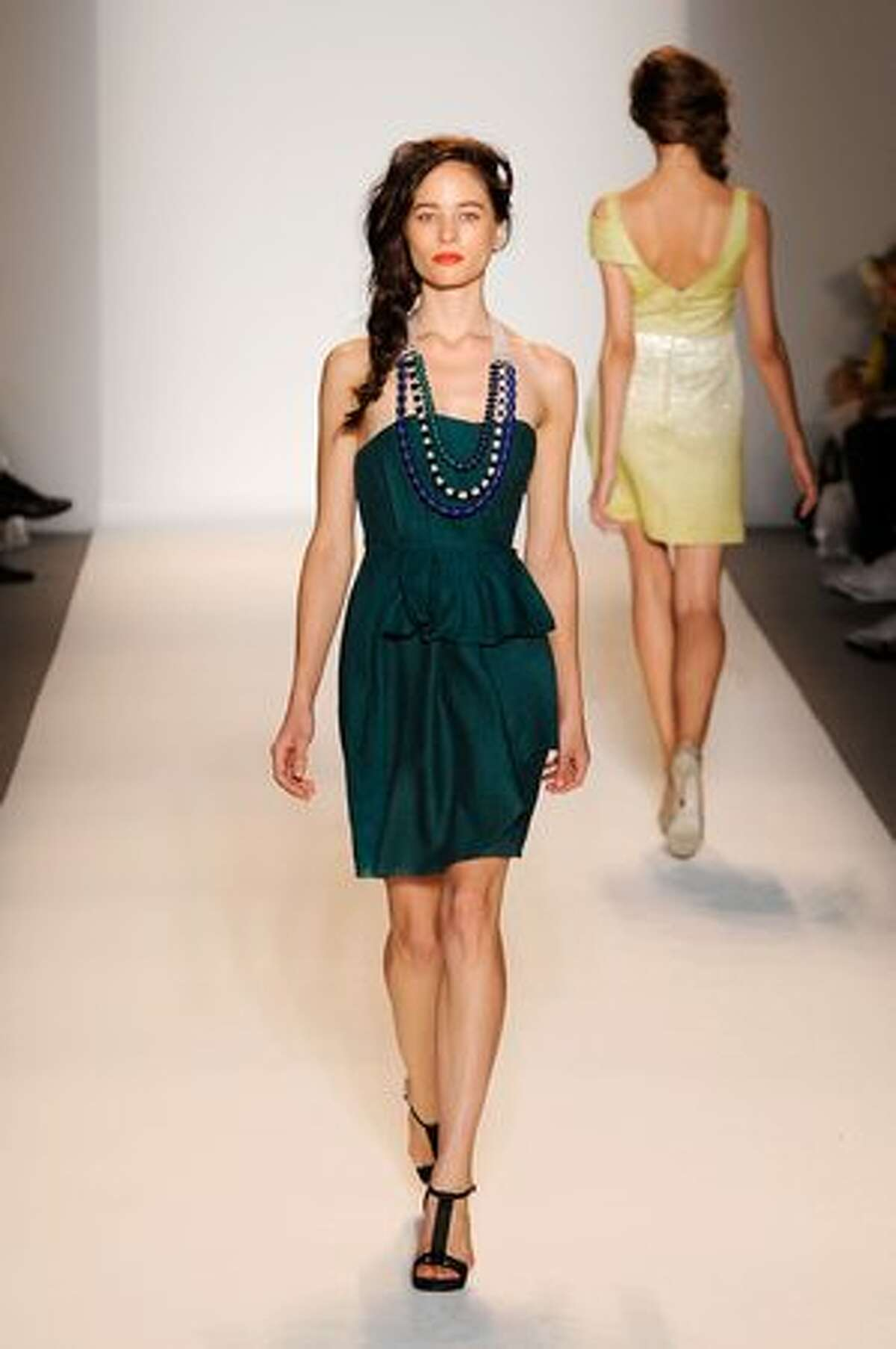 A model walks the runway at the Lela Rose spring 2011 fashion show during the Mercedes-Benz Fashion Week at Lincoln Center in New York on Sunday, Sept. 12, 2010.