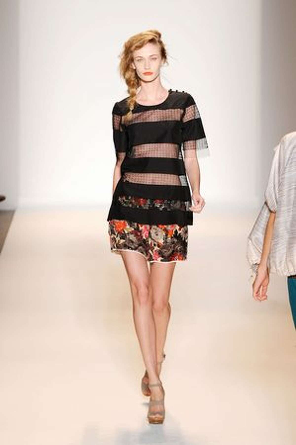 A model walks the runway at the Lela Rose spring 2011 fashion show.