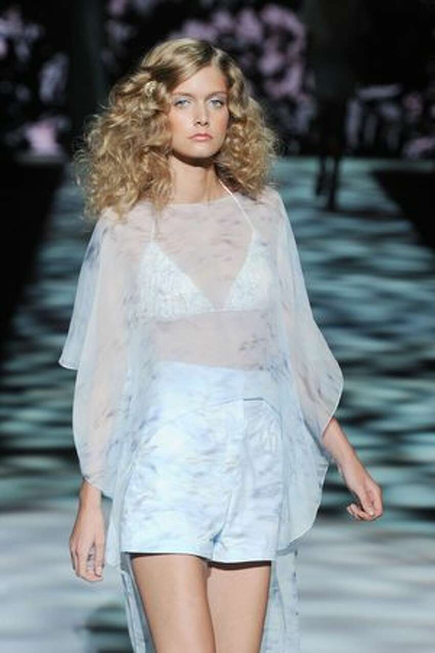 A model walks the runway of the Badgley Mischka Spring 2011 fashion show during Mercedes-Benz Fashion Week in New York City.