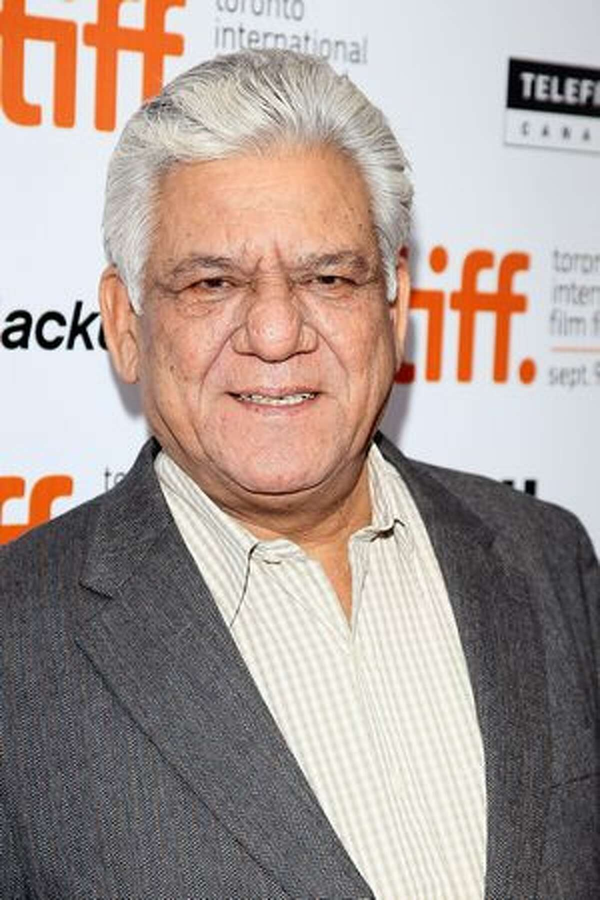 Actor Om Puri attends the