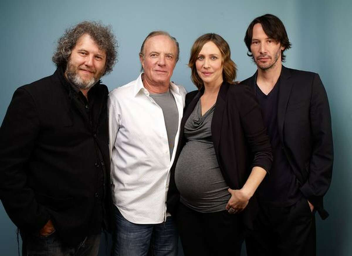 """Director Malcolm Venville, actor James Caan, actress Vera Farmiga and actor Keanu Reeves from """"Henry's Crime"""" poses for a portrait during the 2010 Toronto International Film Festival in Guess Portrait Studio at Hyatt Regency Hotel on Tuesday, Sept. 14, 2010."""