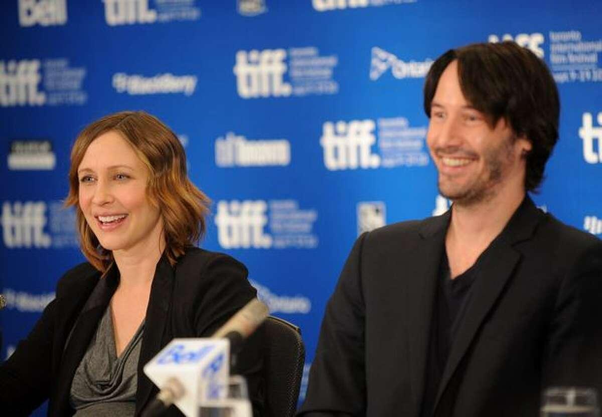 "Actress Vera Farmiga and actor Keanu Reeves speak at ""Henrey's Crime"" press conference."