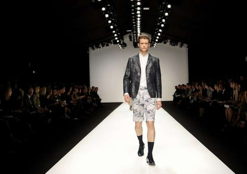 A model walks the runway during the Paul Costelloe Spring/Summer 2011 fashion show during London Fashion Week at the Somerset House on September 17, 2010 in London, England.