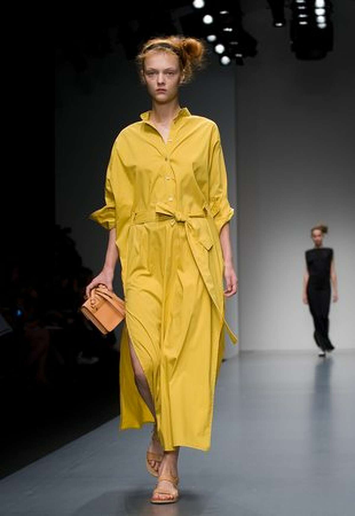 A model walks the catwalk at the Daks fashion show as part of London Fashion Week on Saturday, Sept. 18, 2010.