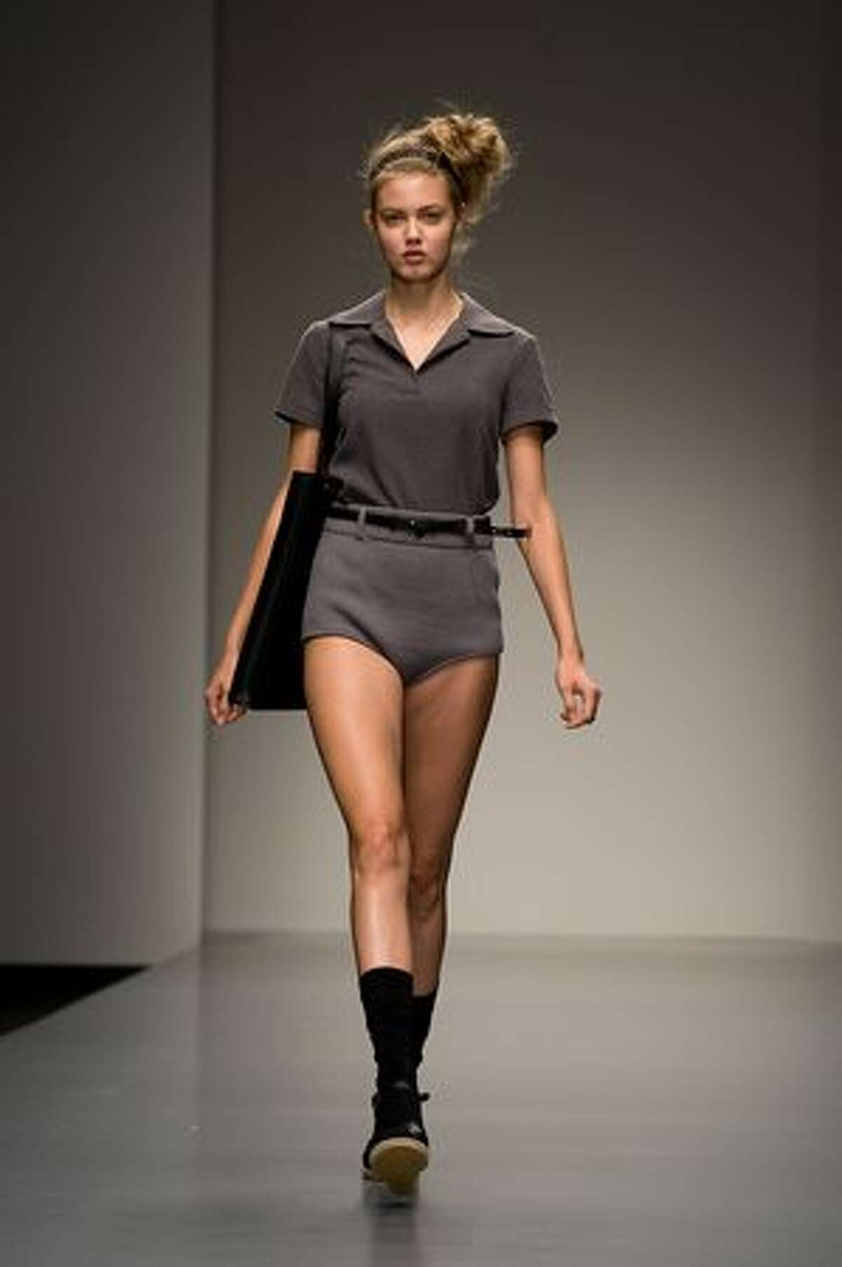 A model walks the catwalk at the Daks fashion show.