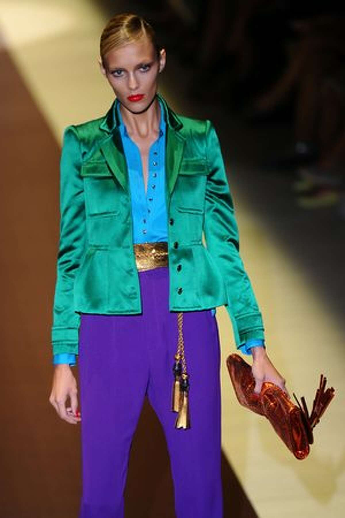 A model displays a creation as part of Gucci spring-summer 2011 ready-to-wear collection during the women's fashion week in Milan.