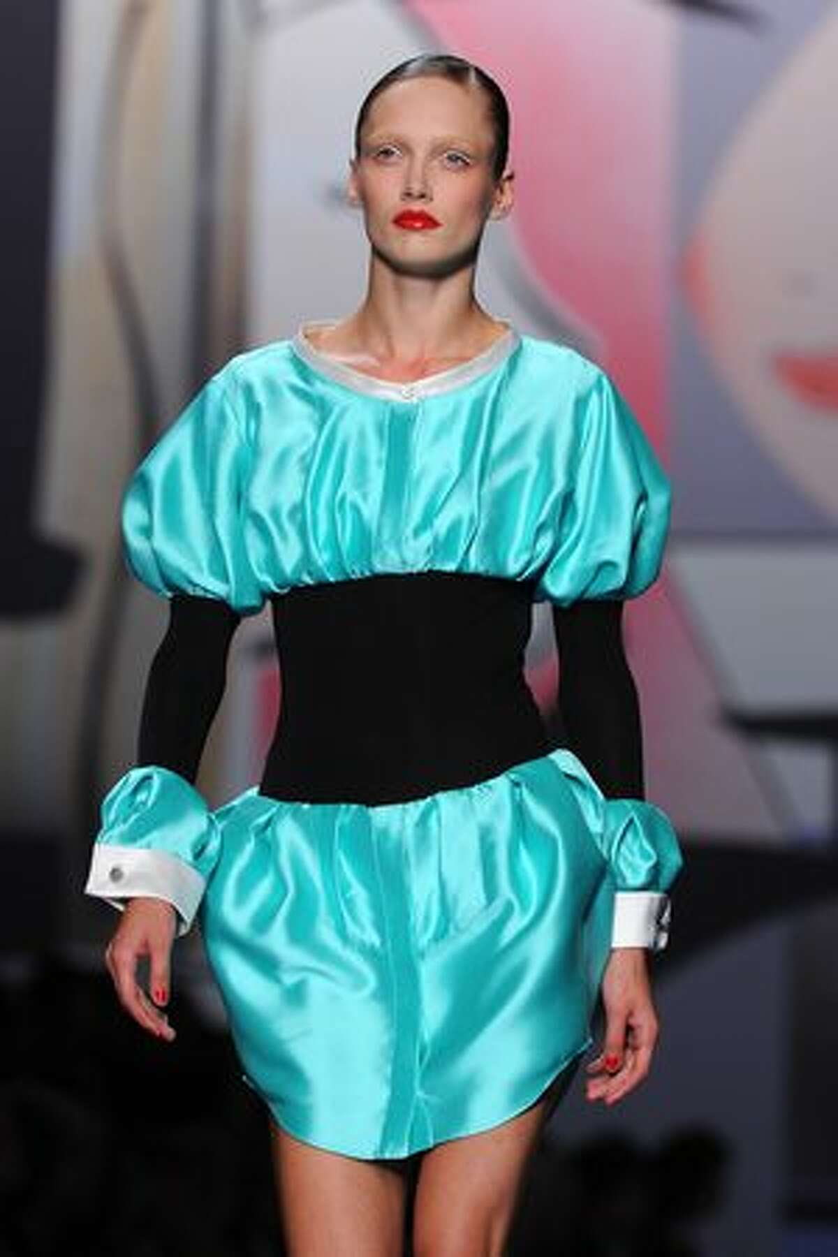 A model displays a creation by Viktor & Rolf.