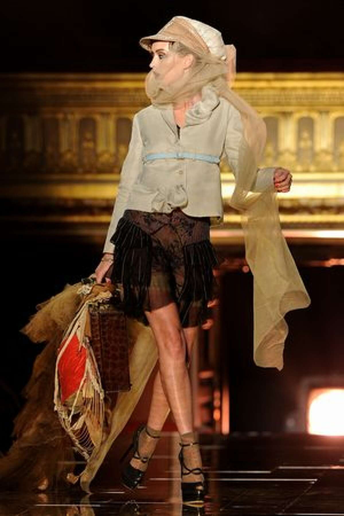 A model walks the runway during the John Galliano ready-to-wear spring/summer 2011 show during Paris Fashion Week at Opera Comique in Paris on Sunday, Oct. 3, 2010.