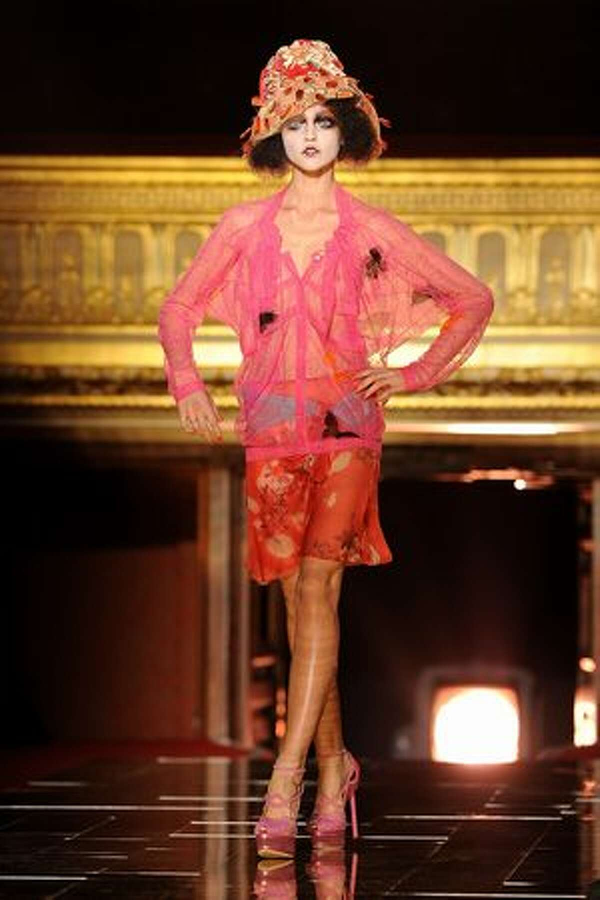A model displays a creation by John Galliano.
