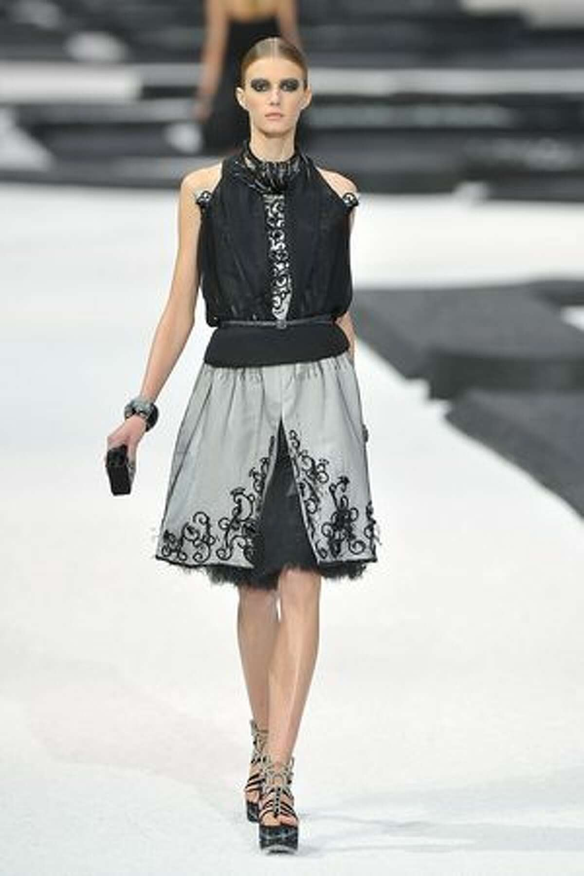 A model walks the runway during the Chanel Ready to Wear Spring/Summer 2011 show during Paris Fashion Week in Paris, France.