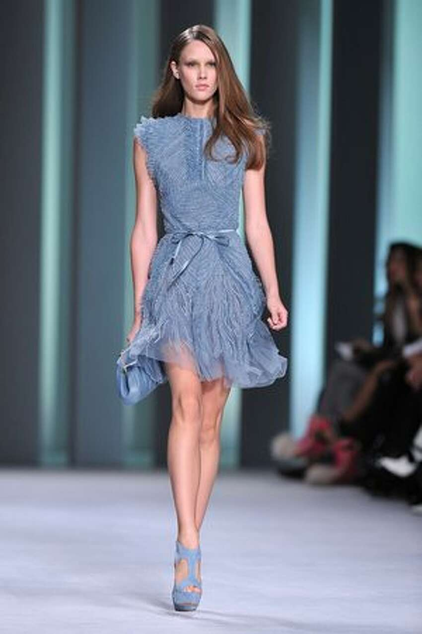 A model walks the runway during the Elie Saab ready-to-wear spring/summer 2011 show during the last day of Paris Fashion Week at Espace Ephemere Tuileries in Paris on Wednesday, Oct. 6, 2010.
