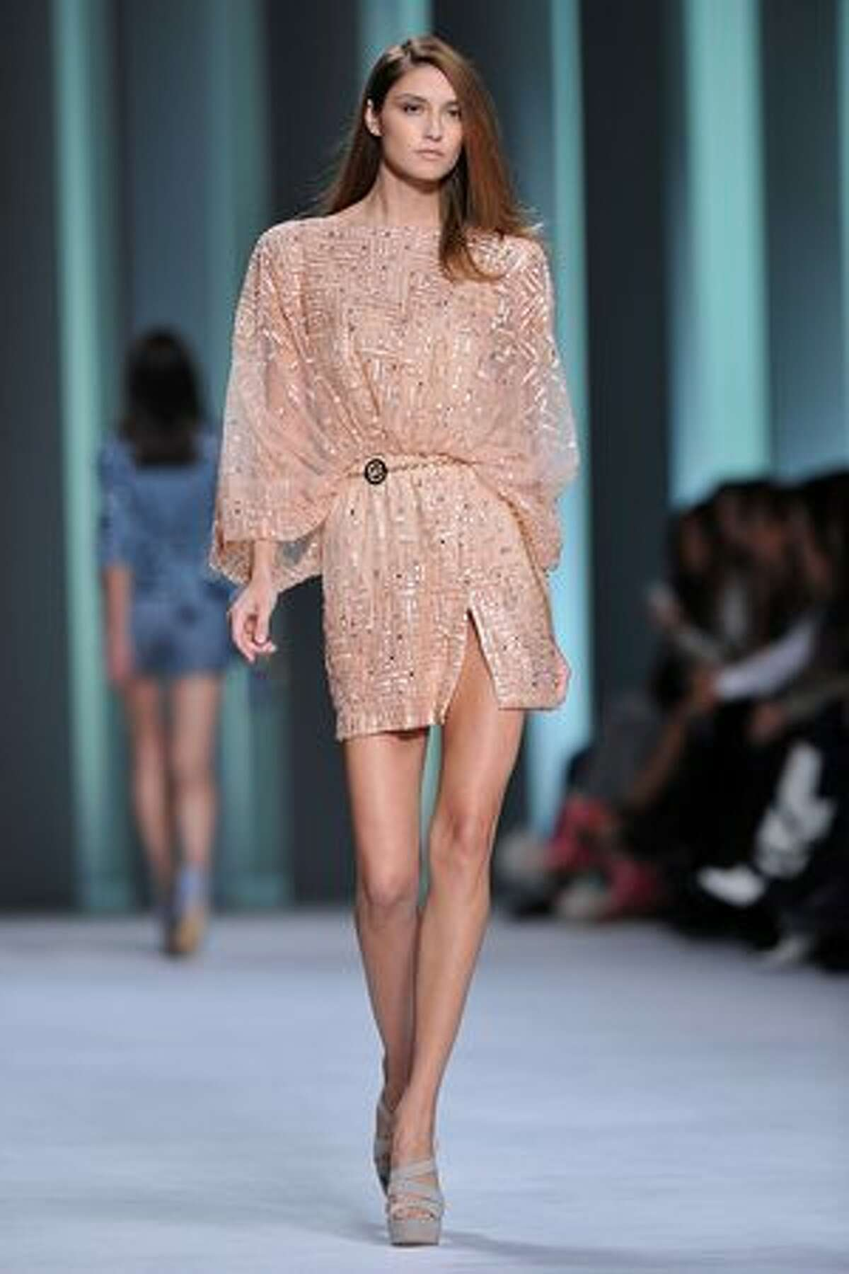A model displays a creation by Elie Saab.