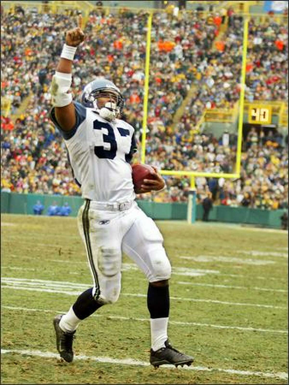 Seattle running back Shaun Alexander glides into the end zone as he went around the left side for his record setting 28th touchdown of the season to break the record he shared with Priest Holmes during the second quarter.