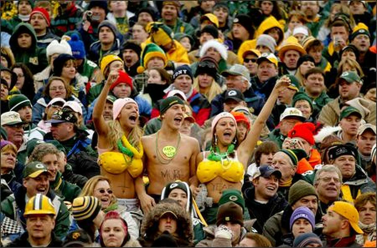 Packers fans get creative with their use of foam cheese as they cheer on their team during the second half.