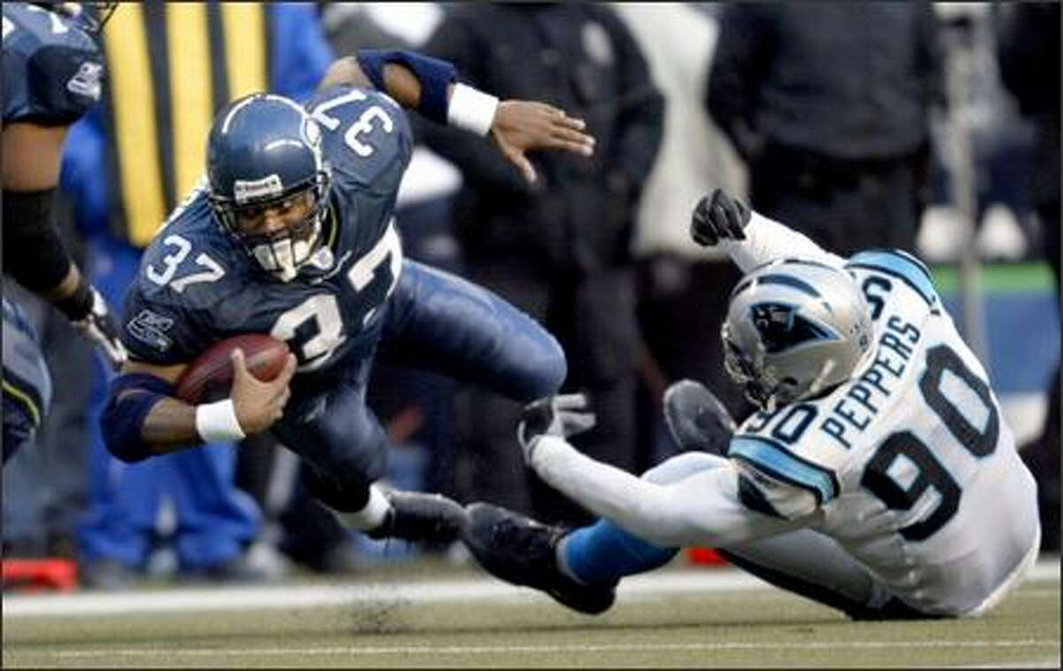 Shaun Alexander, who suffered a concussion a week earlier, set a team playoff record with 132 yards on 34 carries. Alexander, who scored 28 TDs during the regular season, scored twice Sunday.