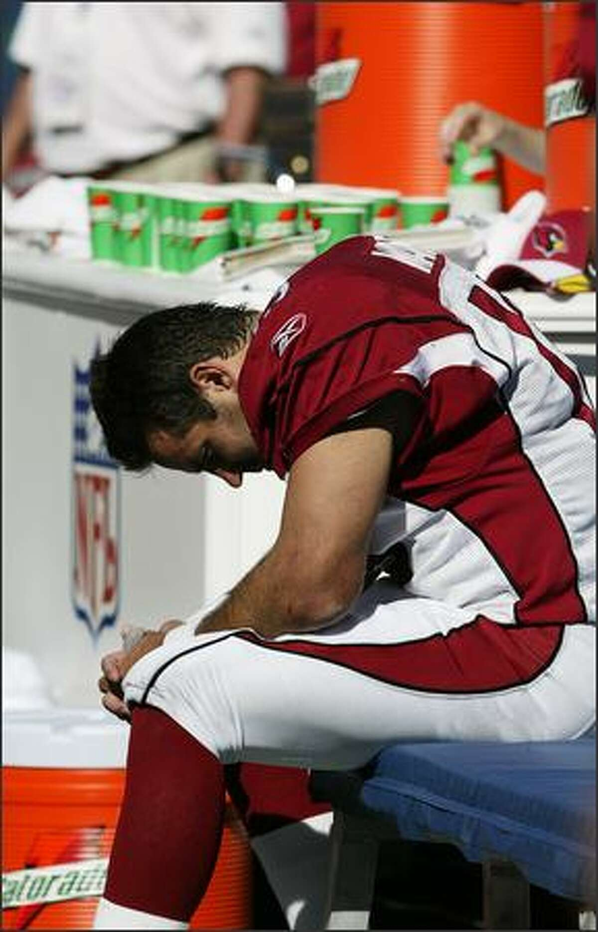 Arizona Cardinals quarterback Kurt Warner sits on the sidelines after suffering a groin injury during second quarter action against the Seahawks.