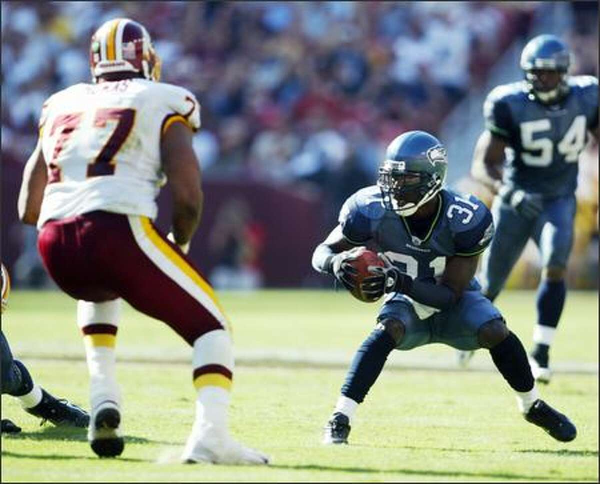 Seattle cornerback Kelly Herndon looks for running room after intercepting a Mark Brunell pass and bringing to the Washington 33 yard line with 49 seconds left in regulation of the Redskins 20-17 win in overtime.