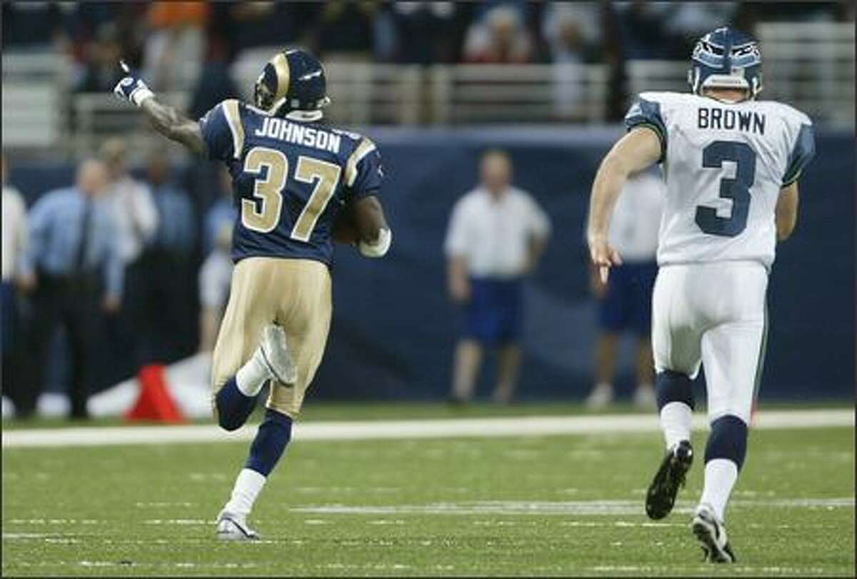 Seattle Seahawks' Josh Brown is the final player to chase St. Louis Rams' Chris Johnson as he runs back the opening kick off for a touchdown.