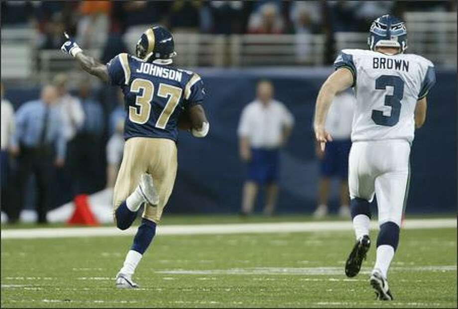 Seattle Seahawks' Josh Brown is the final player to chase St. Louis Rams' Chris Johnson as he runs back the opening kick off for a touchdown. Photo: Mike Urban, Seattle Post-Intelligencer / Seattle Post-Intelligencer