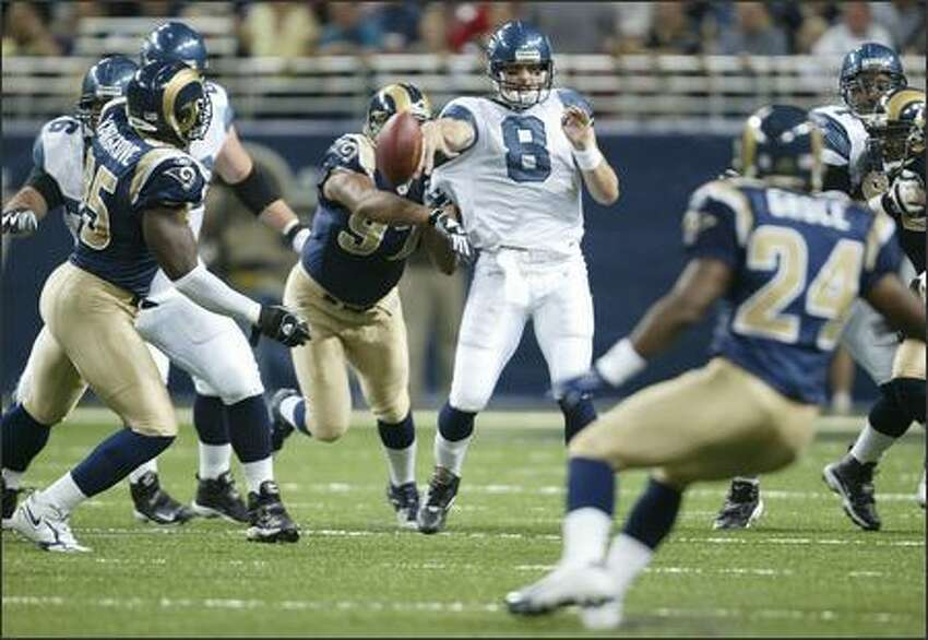 St. Louis Rams' Tyoka Jackson causes Seattle Seahawks' Matt Hasselbeck to blow his throw during first quarter action.