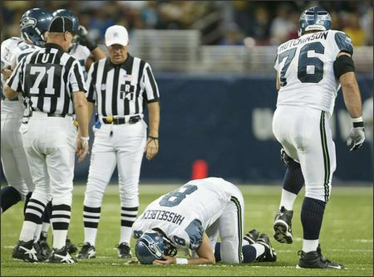 Seattle Seahawks' Matt Hasselbeck is shaken up after an incomplete pass to Jerramy Stevens during first quarter action.