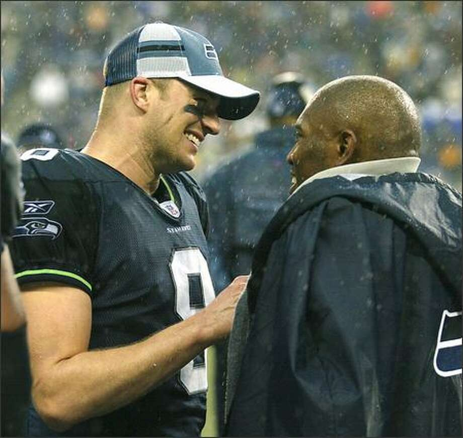 Seahawks' quarterback Matt Hasselbeck and running back Shaun Alexander were all smiles on the sidelines following Alexander's final touchdown in the final minutes of the Seahawks' 31-16 victory over the St. Louis Rams. Photo: Scott Eklund, Seattle Post-Intelligencer / Seattle Post-Intelligencer