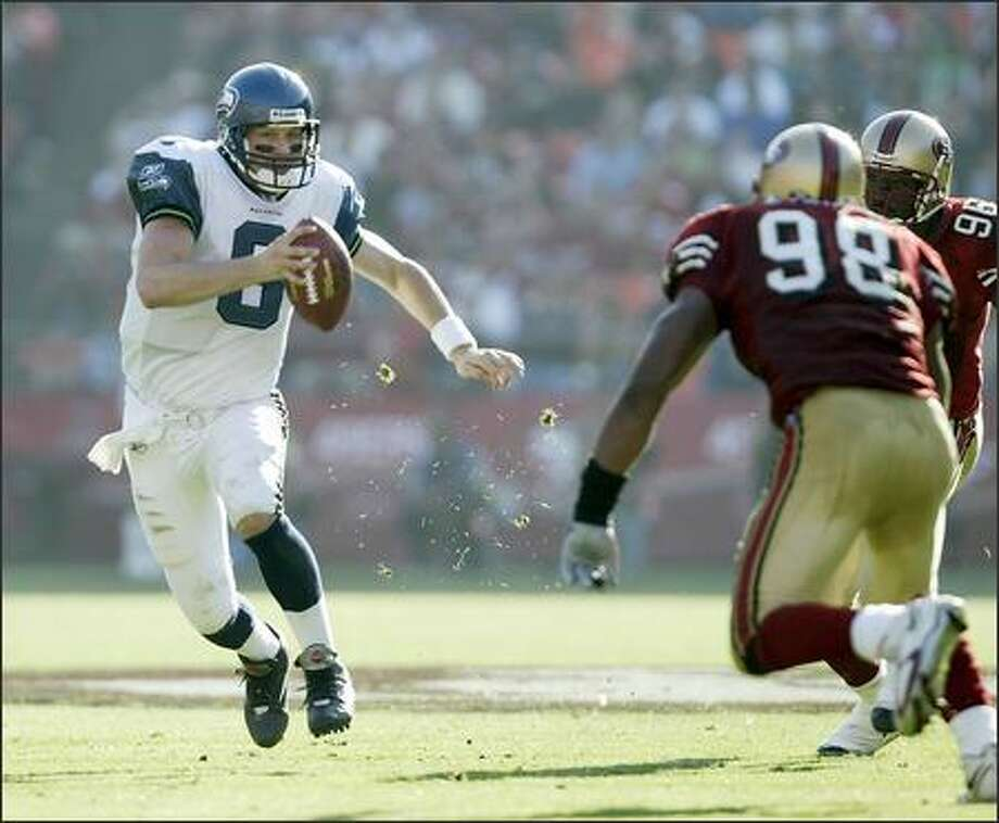 Seattle Seahawks quarterback Matt Hasselbeck scrambles for an eight-yard gain against the San Francisco 49ers during 2nd quarter play. Photo: Dan DeLong, Seattle Post-Intelligencer / Seattle Post-Intelligencer
