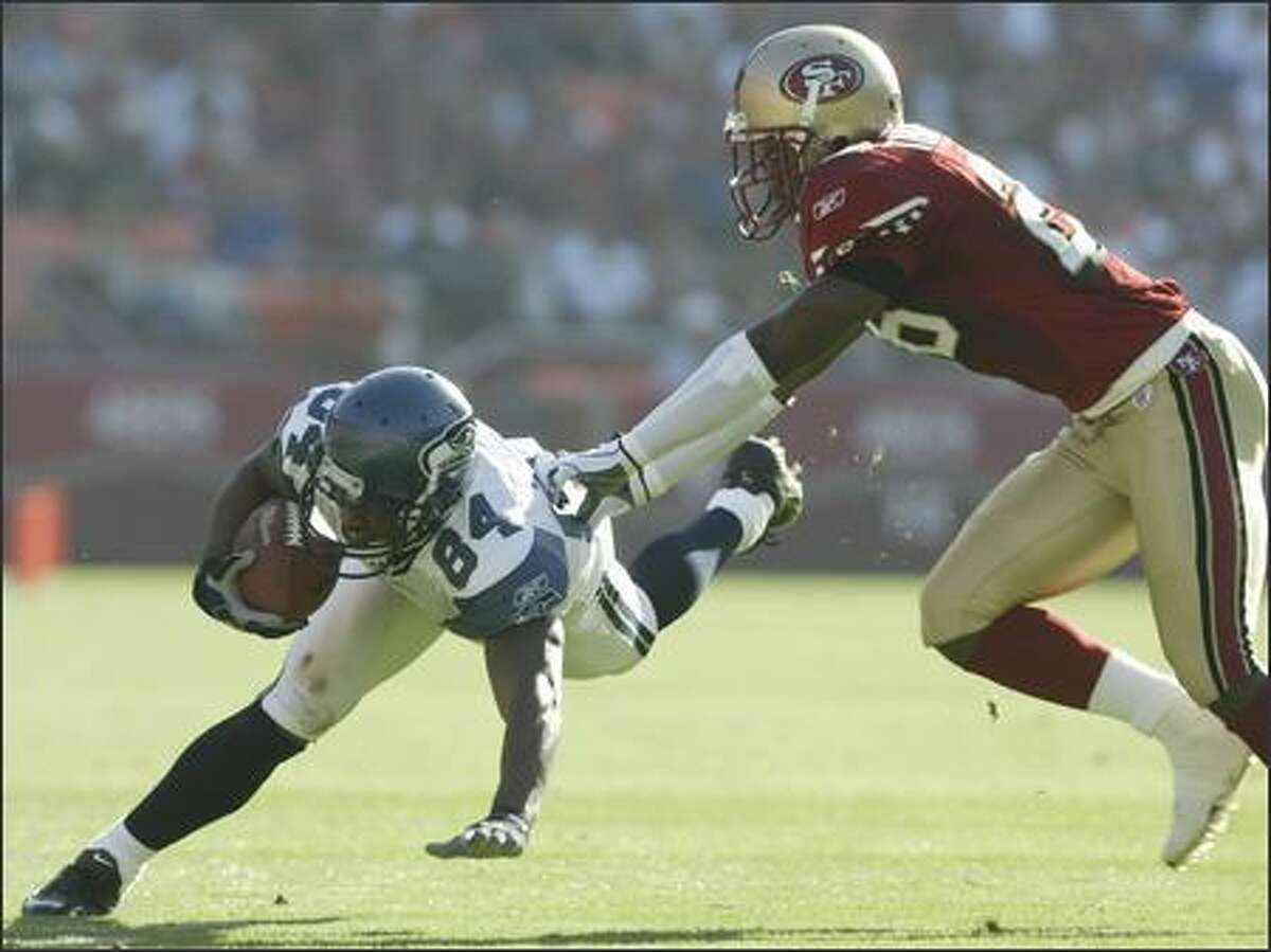 Seattle Seahawks' Bobby Engram is pushed down by San Francisco 49ers cornerback Bruce Thornton after a 25-yard catch during 2nd quarter play.