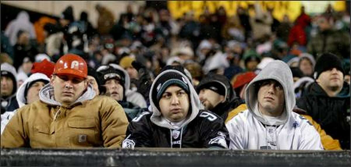 Dejected fans sit through the Eagles' worst home loss since a 49-0 beating by Green Bay in 1962. About three-quarters of the sold-out crowd of 67,637 had left Lincoln Financial Field early in the second half.